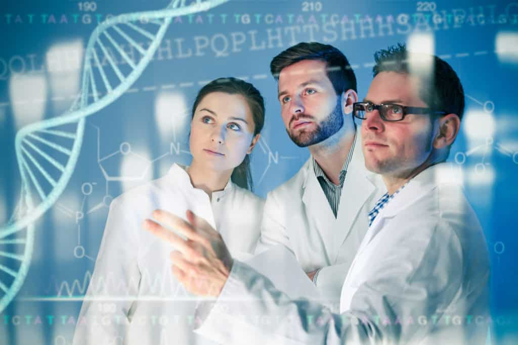 Genetic engineering. Group of scientists working at the laboratory
